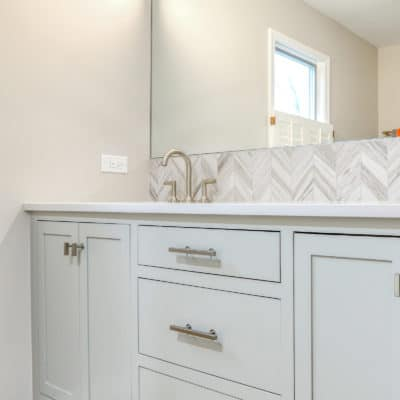 decorative wall tile at bathroom sink with custom mirror