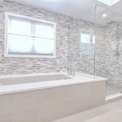 glass tile featured in big shower
