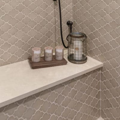 hand made tile in shower with marble seat