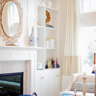 built in white cabinetry next to fireplace