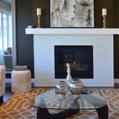 new fireplace featuring white tile