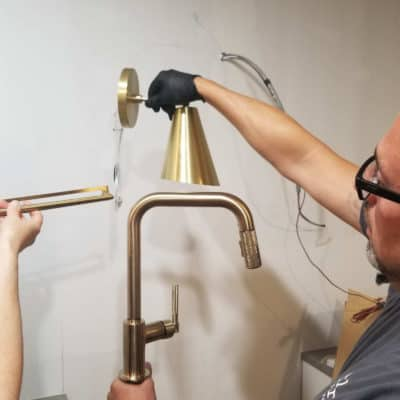 matching finish of brass brizo faucet with cabinet hardware