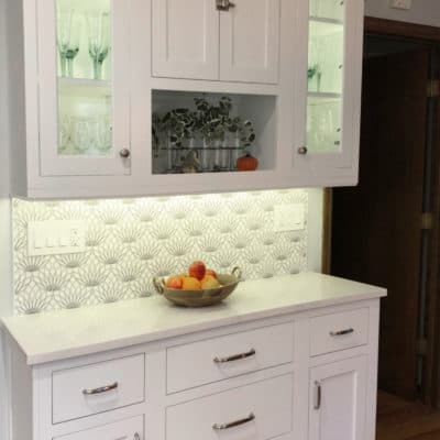 stylish buffet featuring glass doors and patterned tile