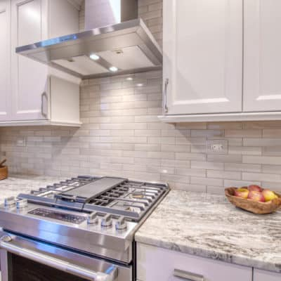 fantasy brown marble counters with white kitchen cabinets
