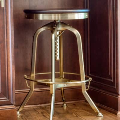 industrial style stool in brass finish