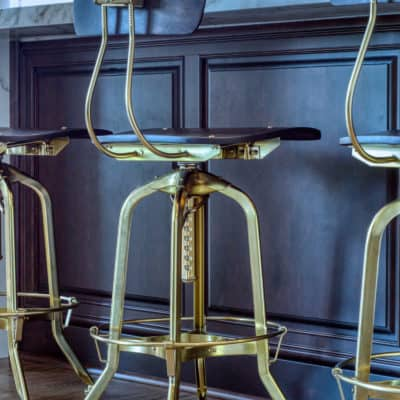 brass bar stools with high back at kitchen island