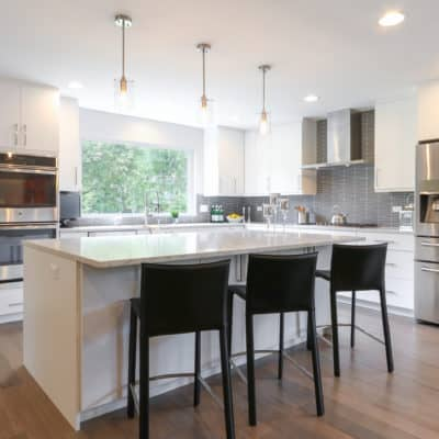 modern white cabinetry shown in slab door style in white painted finish
