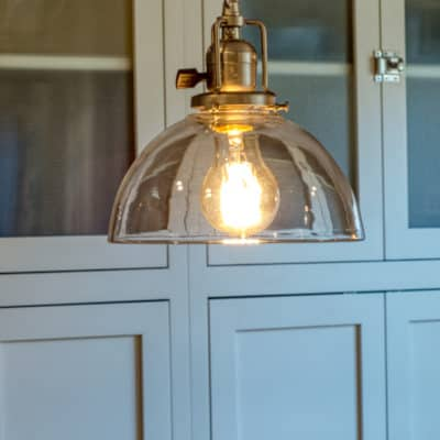 pendant light hanging over island in recent kitchen remodel