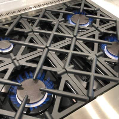 professional grade viking range with burners turned on