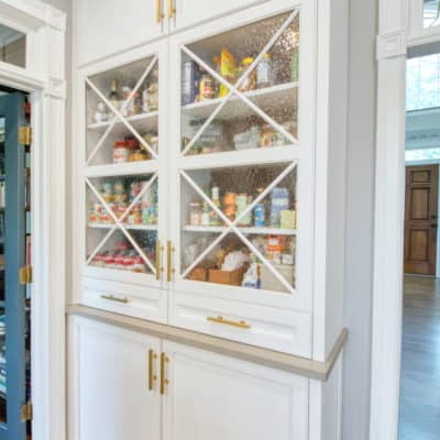 unique storage pantry featured in white painted kitchen